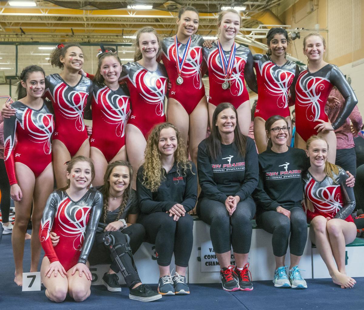 Sun Prairie's gymnastics team celebrates its Big Eight Conference team title
