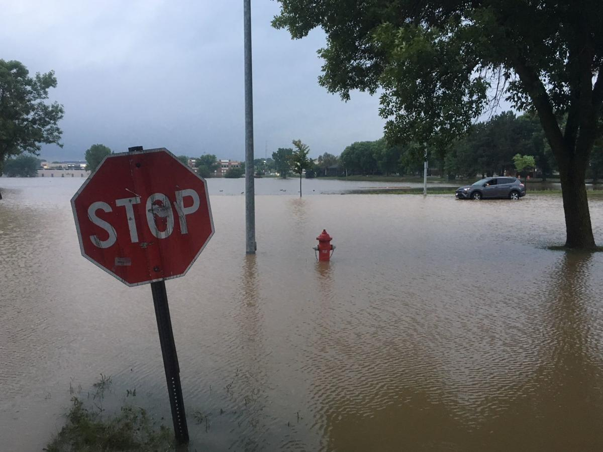Damage widespread, 1 dead after record rainfall causes flash