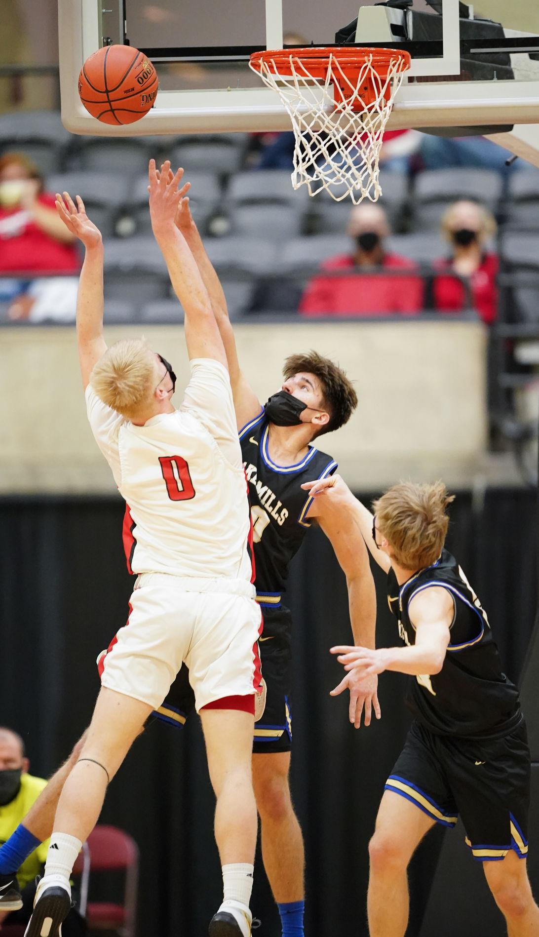 WIAA state boys basketball photo: Lake Mills' Jaxson Retrum goes up to defend a drive