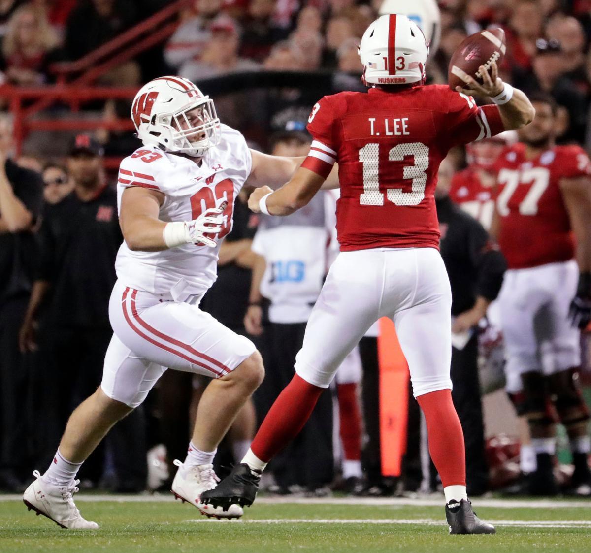 Garrett Rand pressures Nebraska QB Tanner Lee, State Journal photo
