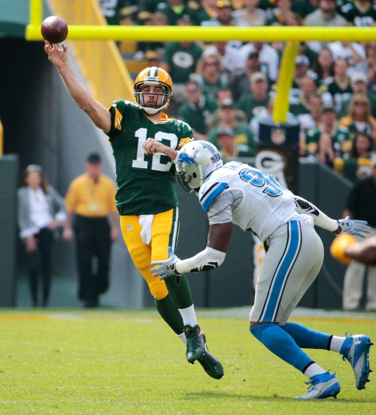Aaron Rodgers Throws Against Lions AP Photo