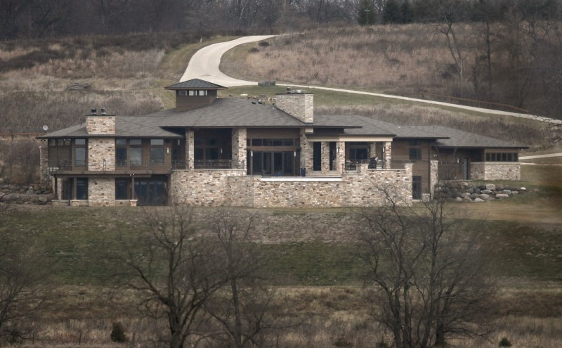 Luxury bank-owned home with private lake listed for sale at