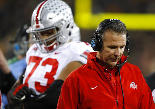 Dejected Urban Meyer, AP photo