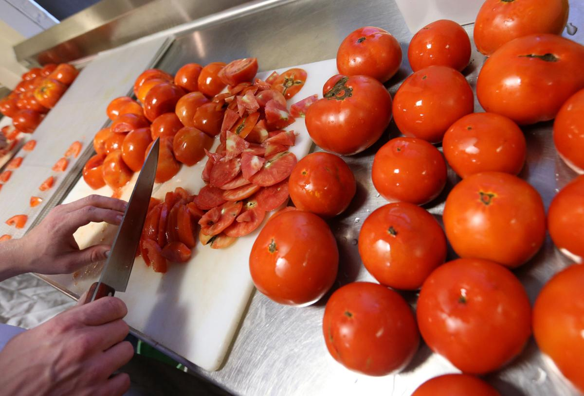 Photos Prepping Tomatoes At The Goodman Community Center S