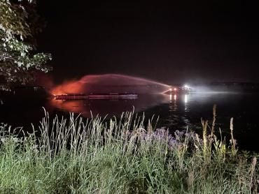 Boat fire being put out by MFD