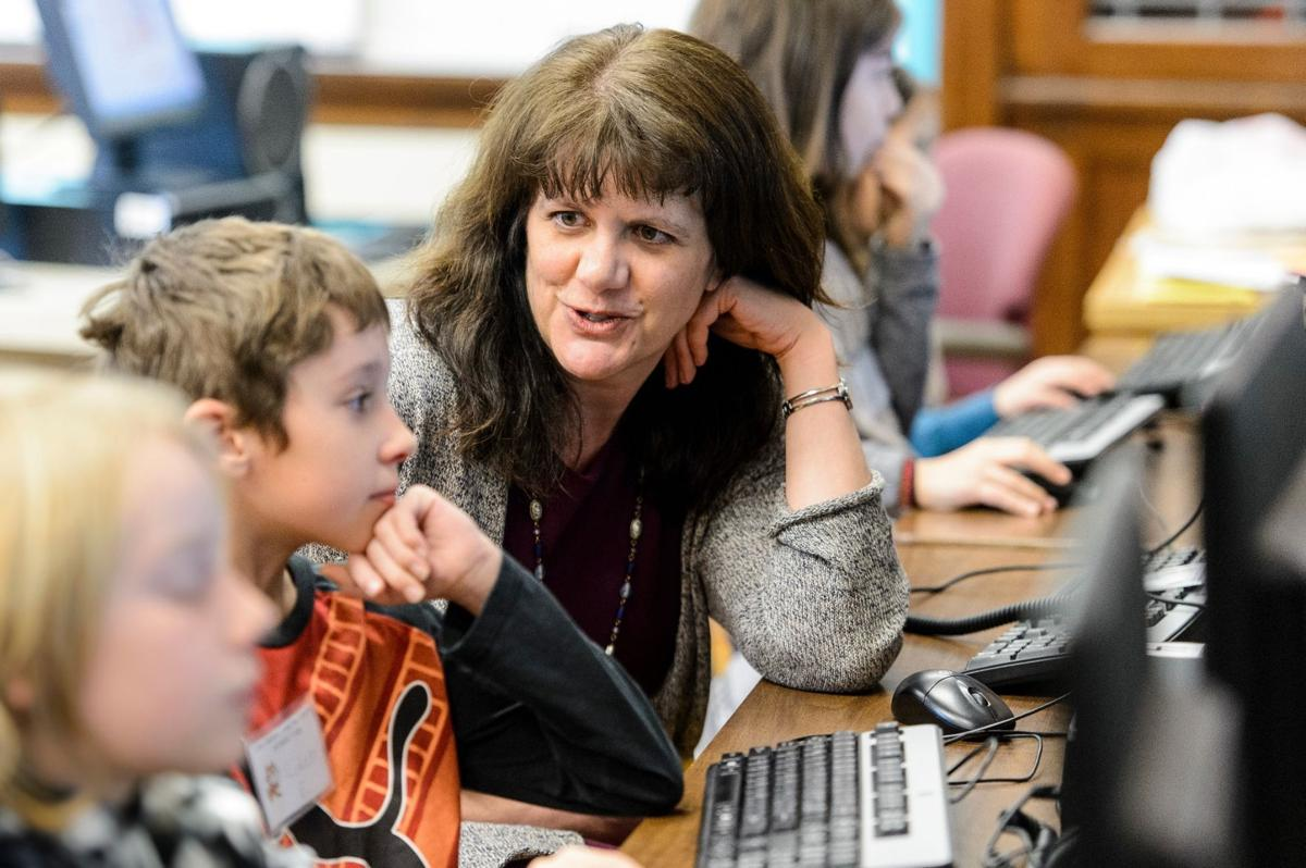 Professor Andrea Arpaci-Dusseau works with students