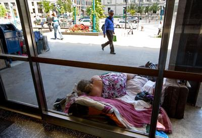 Person lying outside City-County Building