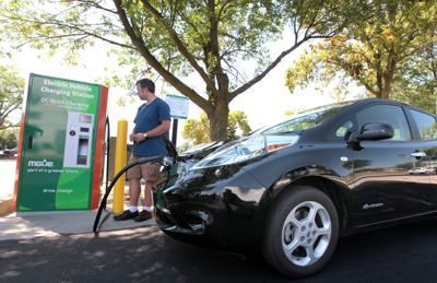 Nissan Leaf electric vehicle charging, State Journal photo