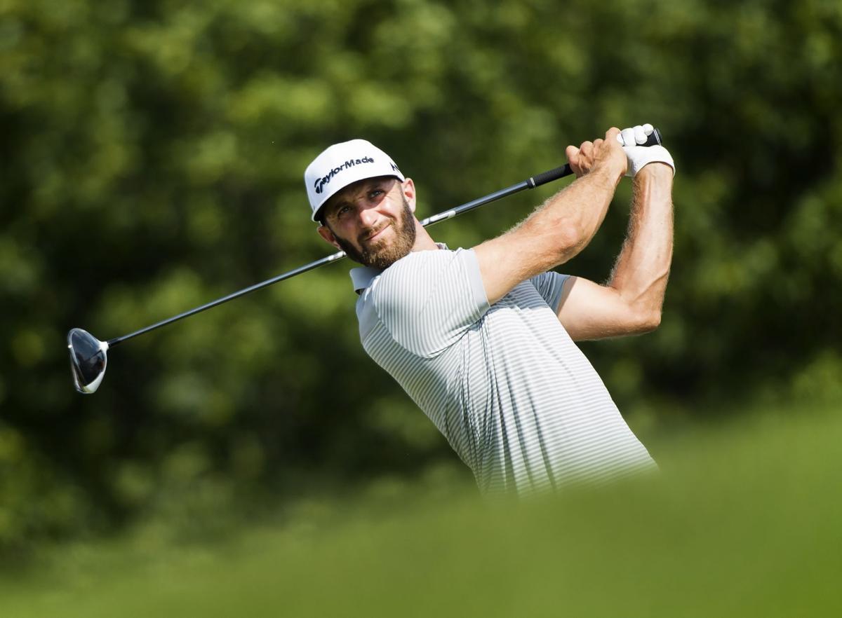 Dustin Johnson hitting, AP photo