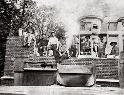 Men constructing University Club