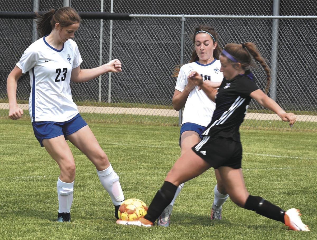 WIAA girls soccer photo: Waunakee's Josie Bono, Watertown's Lily Gifford
