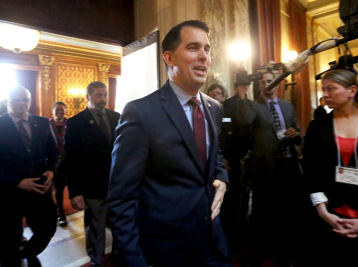 Scott Walker calls for the state to cover state employee health insurance