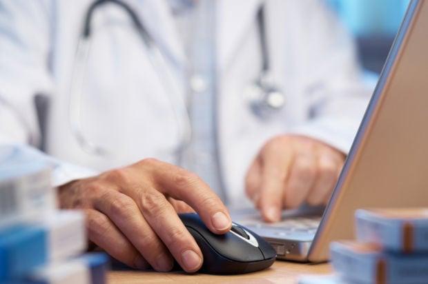Doctor preparing online prescription