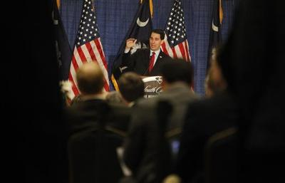 Walker pairs common-man pitch with GOP checklist
