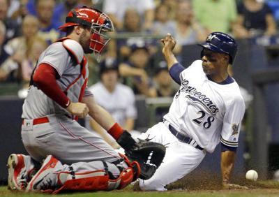 Curtis Granderson slides home, AP photo