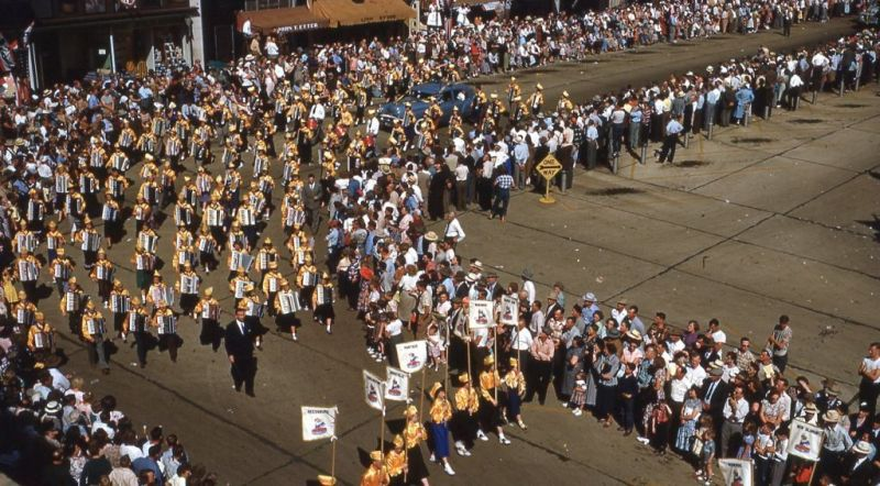This 1950 Cheese Days accordionist parade entry has its own color guard