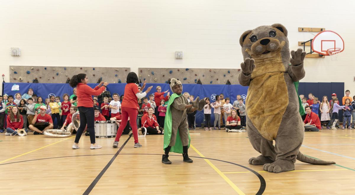 Mascot Swimmy gets Olson Elementary students in the school spirit
