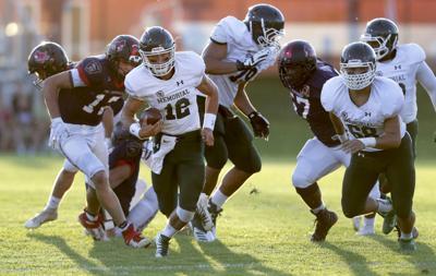 Prep football photo: Madison Memorial's Jason Ceniti against Sun Prairie