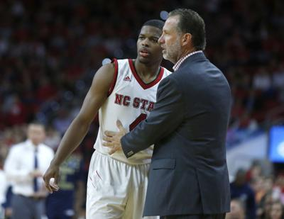 North Carolina State head coach Mark Gottfried talks with Dennis Smith Jr. (4) during action against Georgia Southern at the PNC Center in Raleigh, N.C., on November 11, 2016.