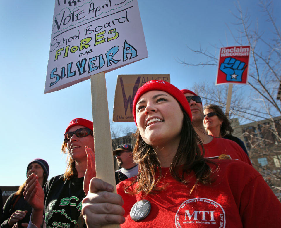Madison teacher Kati Walsh holding sign at Capitol protest, 2012 State Journal photo