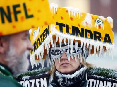 Packers fan in icy cheesehead, AP photo