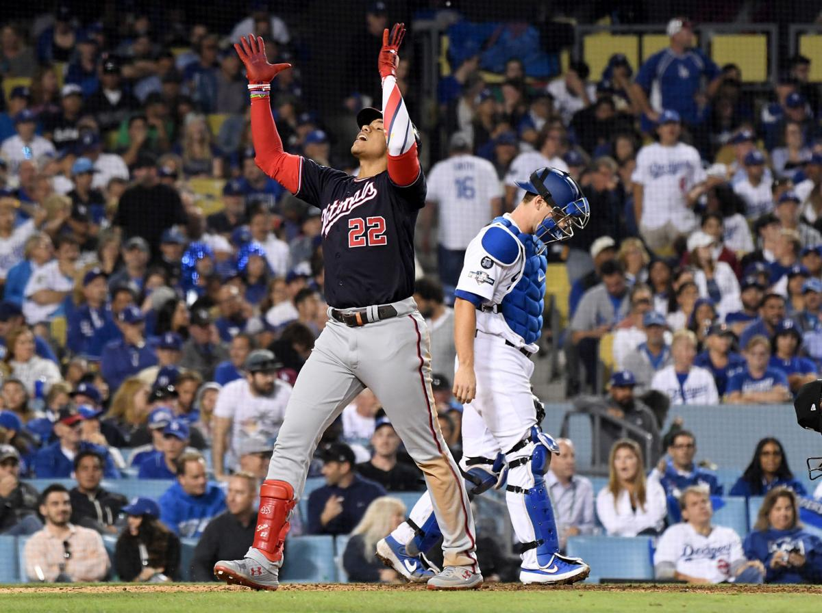 The Washington Nationals' Juan Soto celebrates as he crosses home plate after hitting a solo home run to tie the game against the Los Angeles Dodgers in the eighth inning during Game 5 of the National League Division Series at Dodger Stadium in Los Angeles on Wednesday, Oct. 9, 2019.
