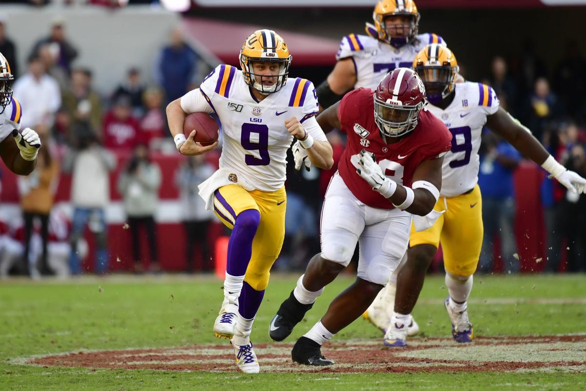 Joe Burrow runs, AP photo
