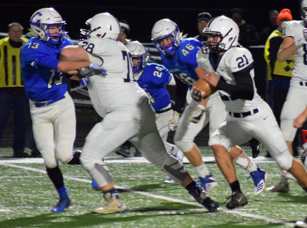 Prep football photo: Lakeside Lutheran's Casey Ponyicsanyi takes on Lodi