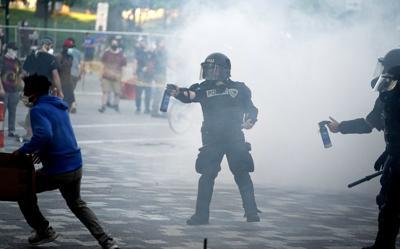 Police spray protesters