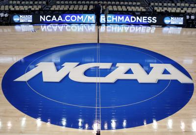 NCAA logo on basketball court, AP photo