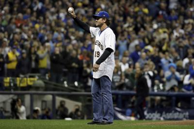 c0a35fd44 Robin Yount throws a ceremonial first pitch before Game 7 of the National  League Championship Series between the Milwaukee Brewers and the Los  Angeles ...