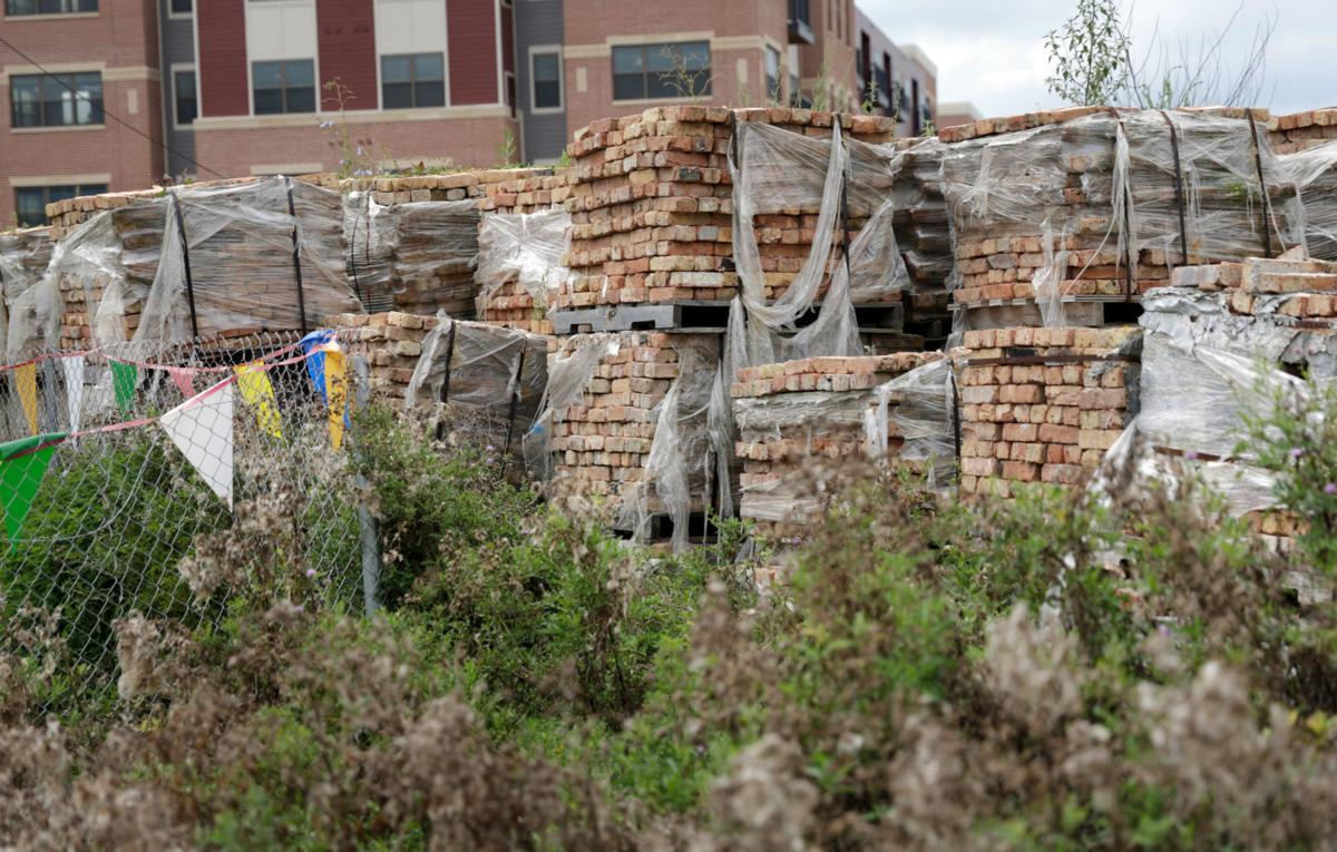 Pallets of old bricks at Union Corners site