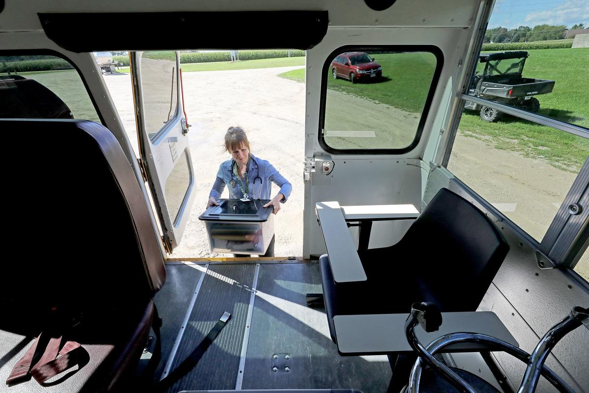 Jewell taking supplies from bus