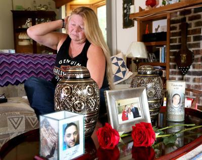Sherri Smith behind urns