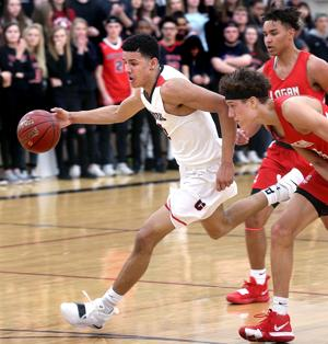 'Dream come true:' Twins Johnny and Jordan Davis' commitment to Badgers fulfills their father's vision