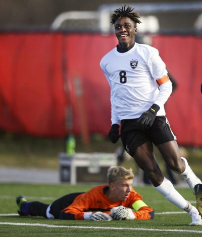 WIAA state boys soccer photo: Madison Conduah all smiles after a goal