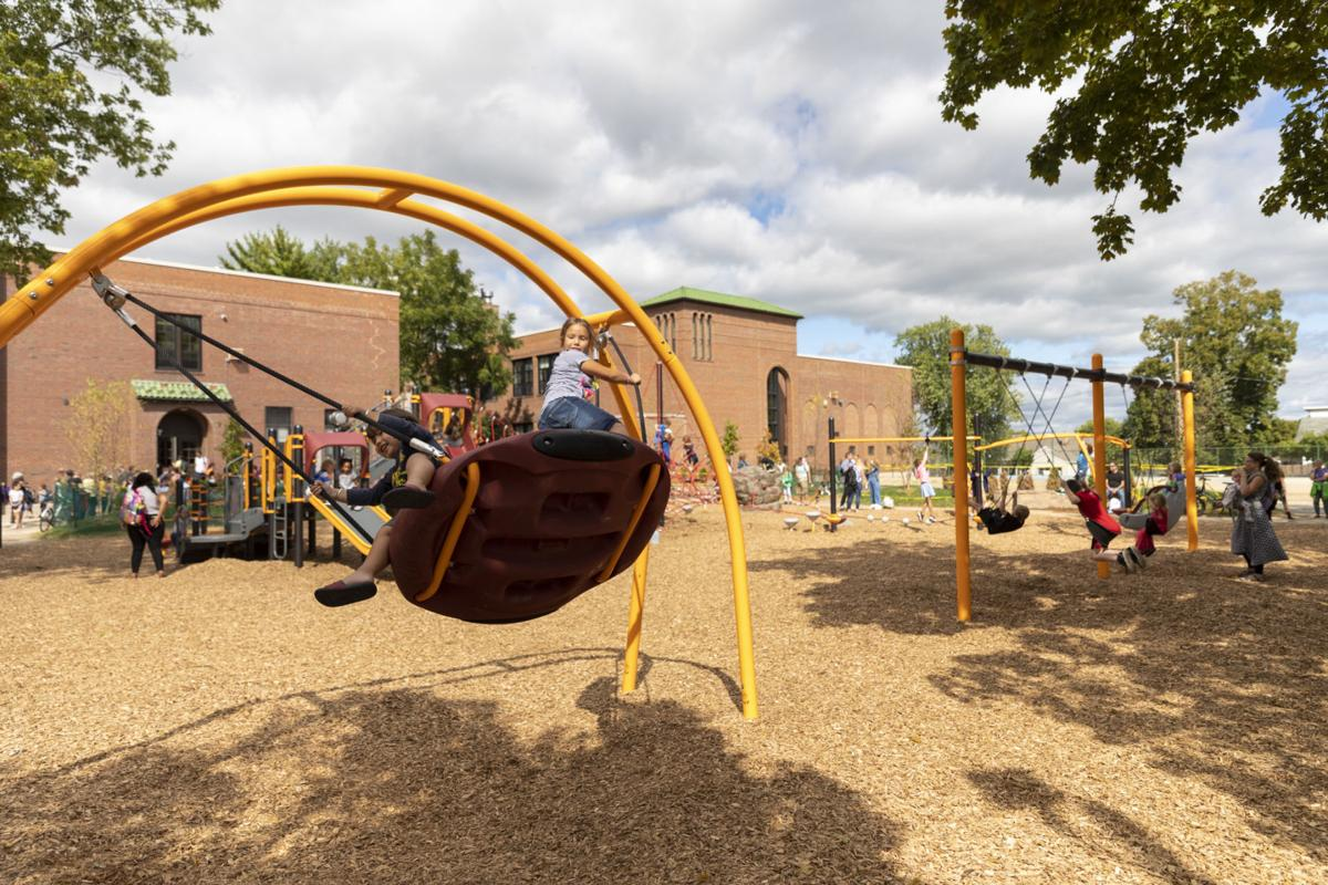 Students play on new equipment at Lowell Elementary School