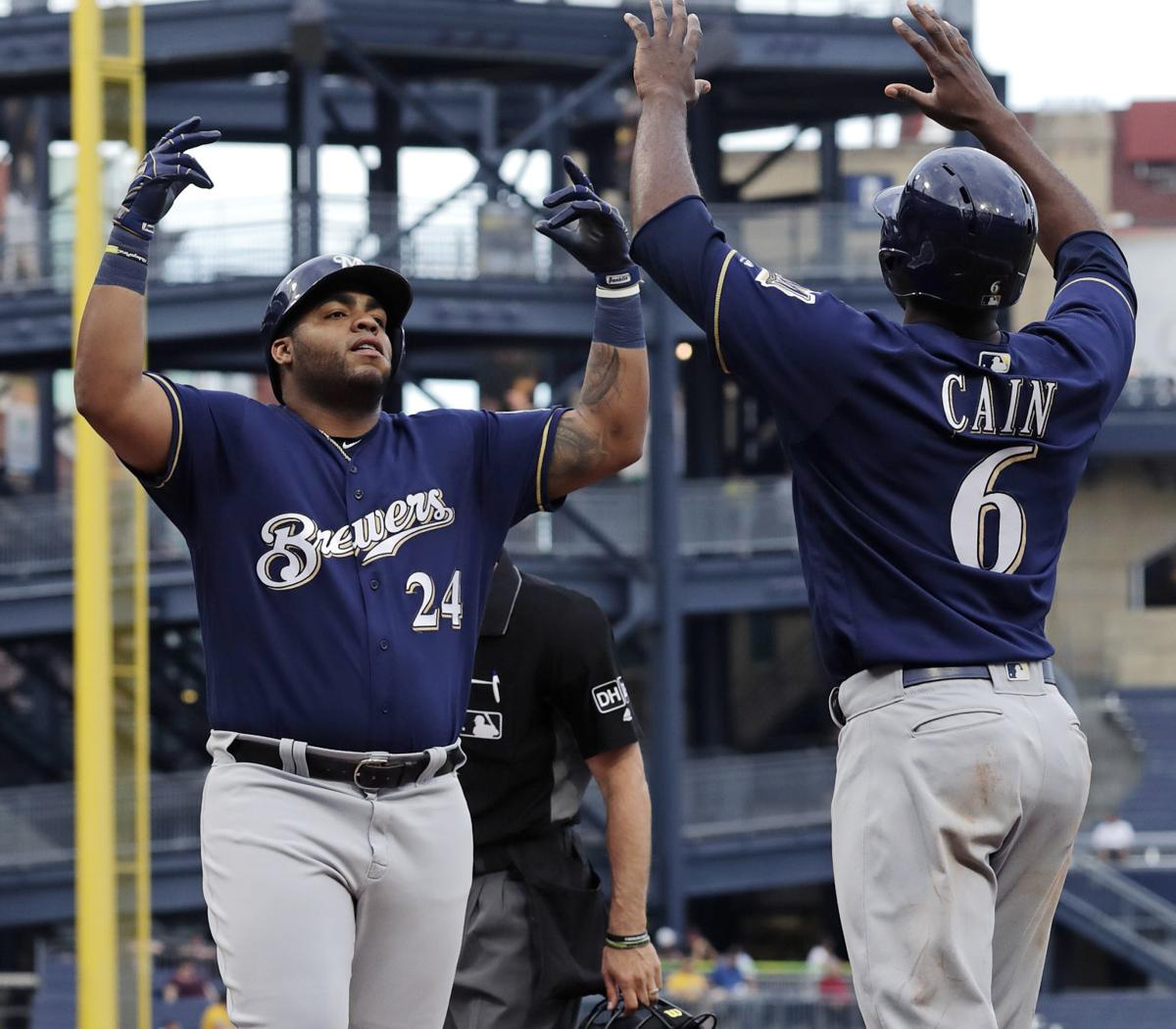 Jesus Aguilar, Lorenzo Cain celebrate, AP photo