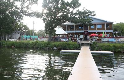 Every summer on Lake Waubesa, pontoons pack 'em in at Christy's Landing