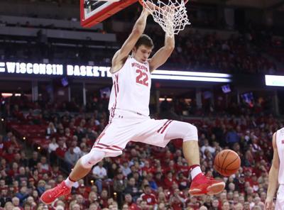 Ethan Happ dunks, State Journal photo