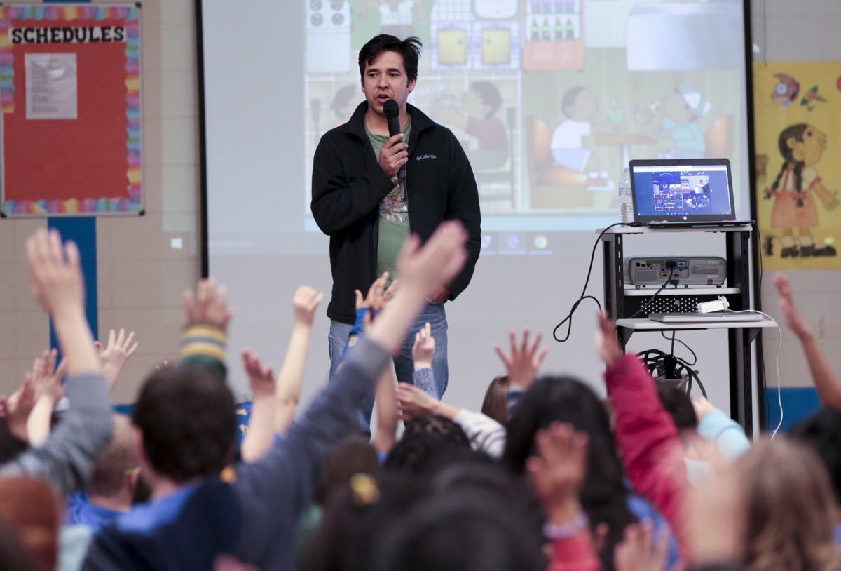 Duncan Tonatiuh speaks with students