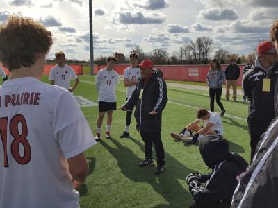 WIAA state boys soccer photo: Sun Prairie coach Tok Kim talks to his players