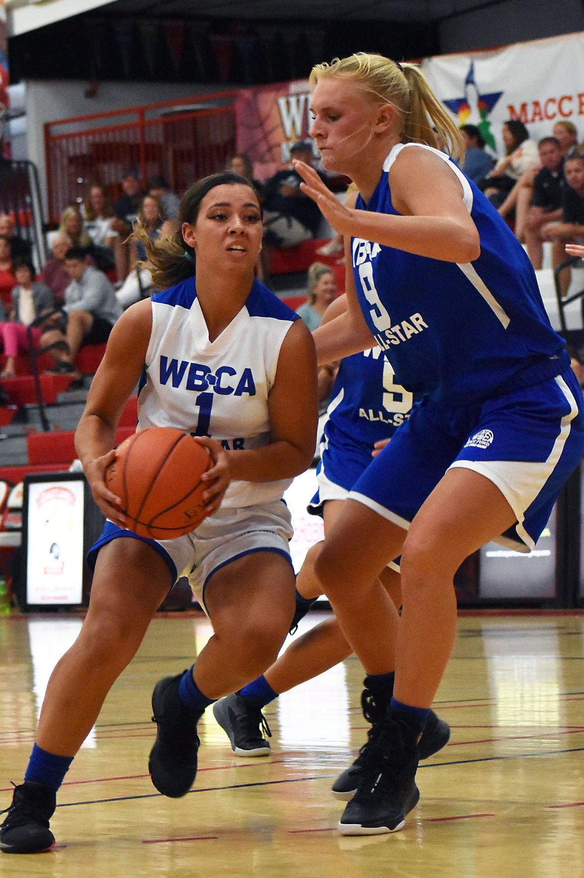 Prep girls basketball photo: Memorial's Mia Morel and Watertown's Teya Maas