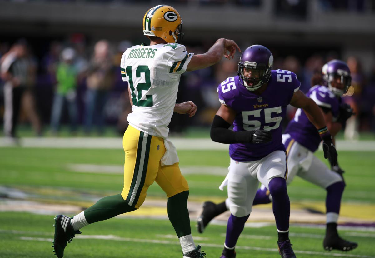 Anthony Barr, Aaron Rodgers, injury, AP photo