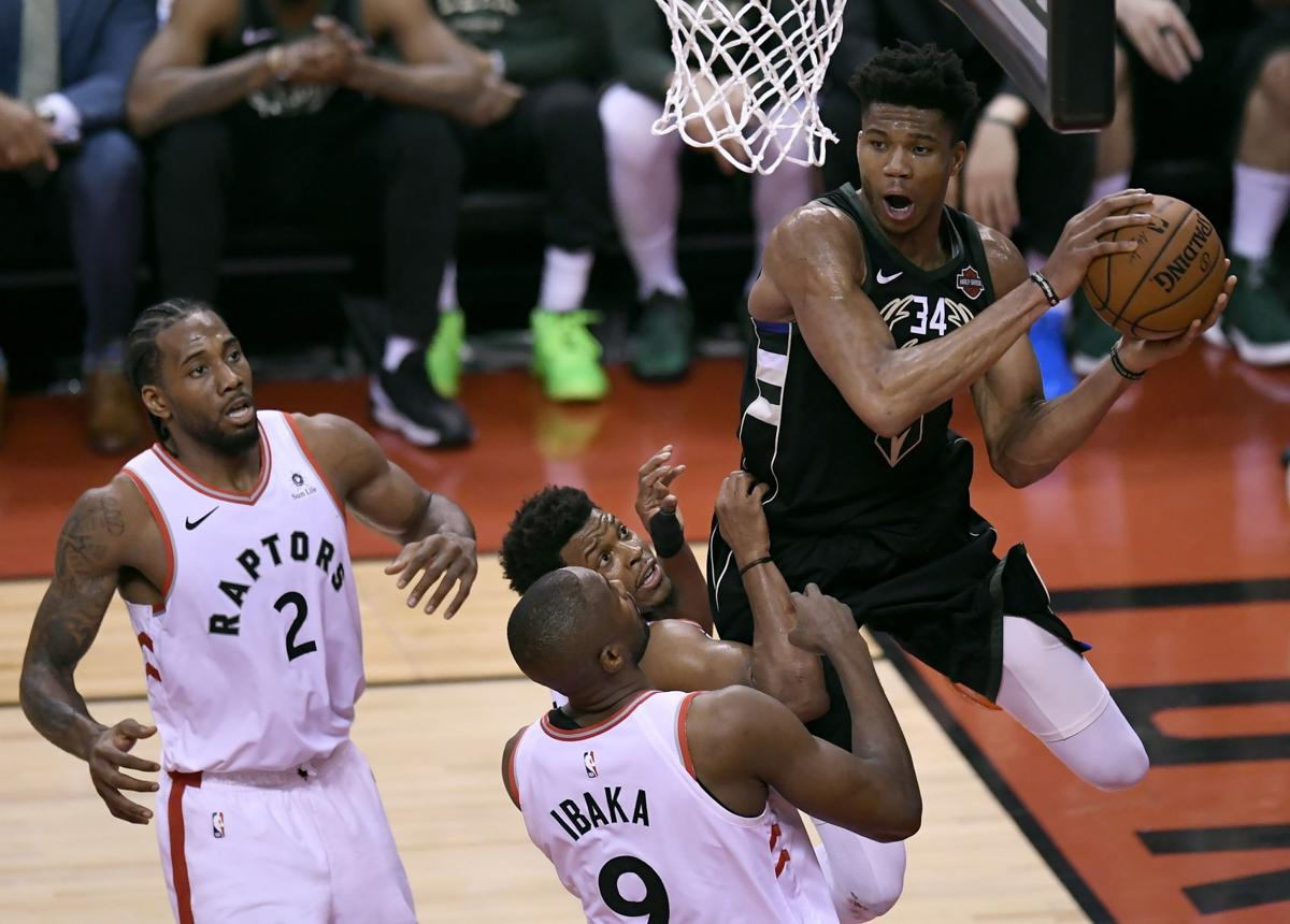 Giannis Antetokounmpo swarmed by Raptors, AP photo
