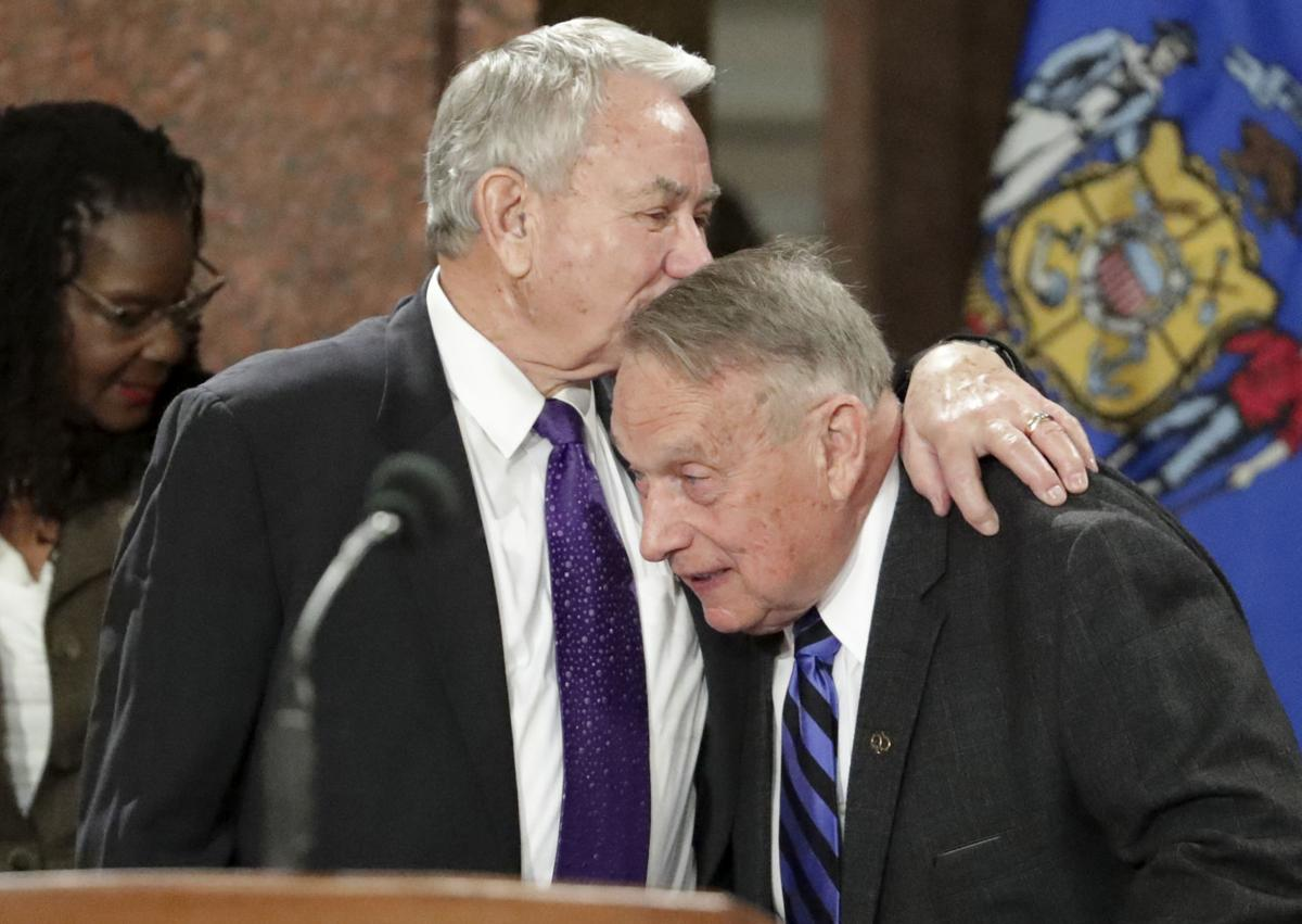 Former governors embrace at inauguration ceremony