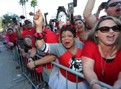 """Georgia fans cheer as the team arrives at EverBank Field in Jacksonville, Fla., on October 28, 2017, for what is known in some circles as """"The World's Largest Outdoor Cocktail Party."""""""