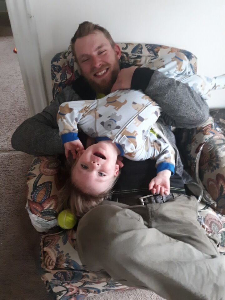 Aric Michael Lantz, 28, plays with his son Carter Thomas Lantz.