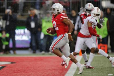 J.K. Dobbins scores against Badgers, AP photo