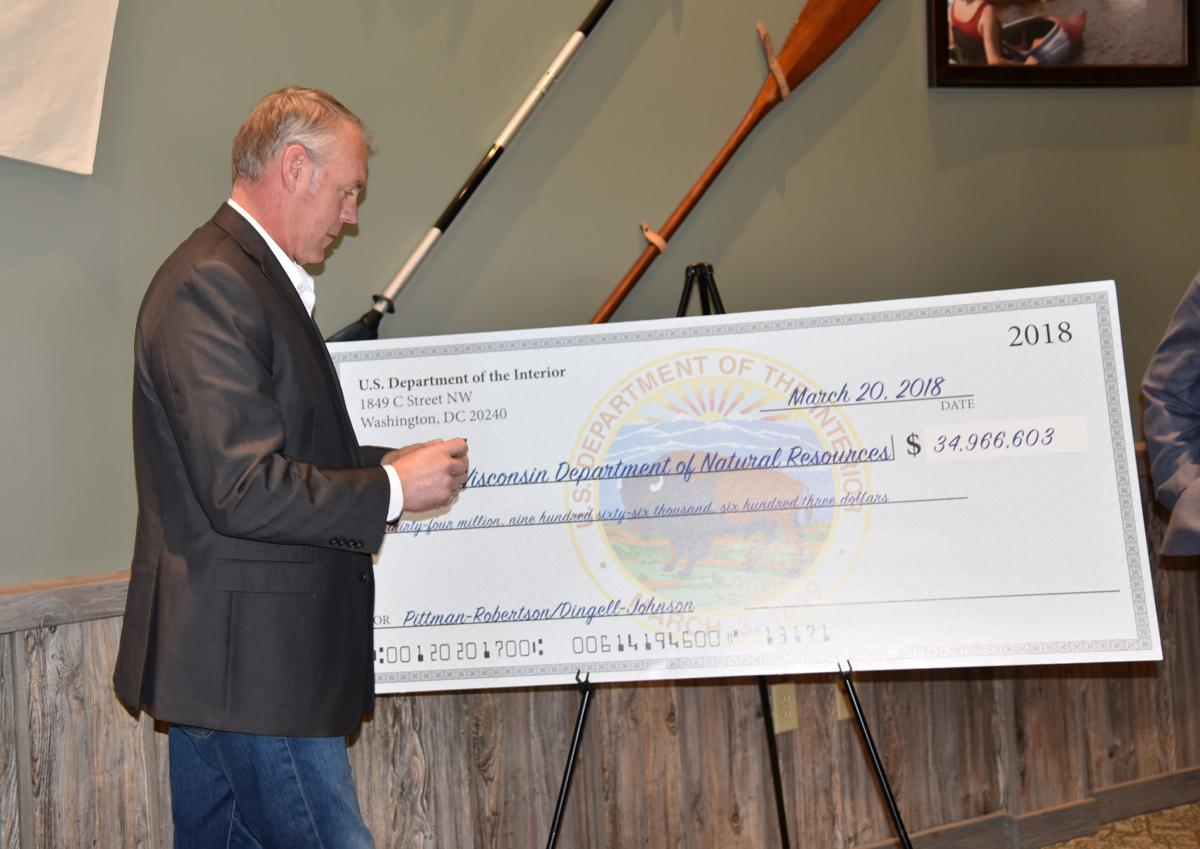 Ryan Zinke big check